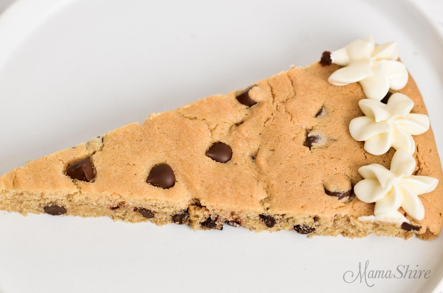 A slice of gluten-free pizza cookie.