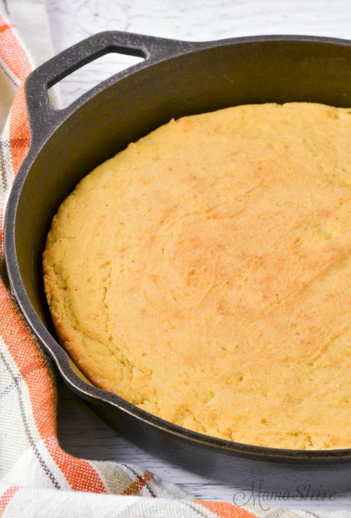 Gluten-Free Cornbread baked in a cast iron skillet.