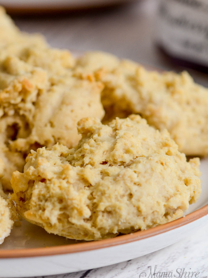 A plate of gluten-free drop biscuits that are also dairy-free.