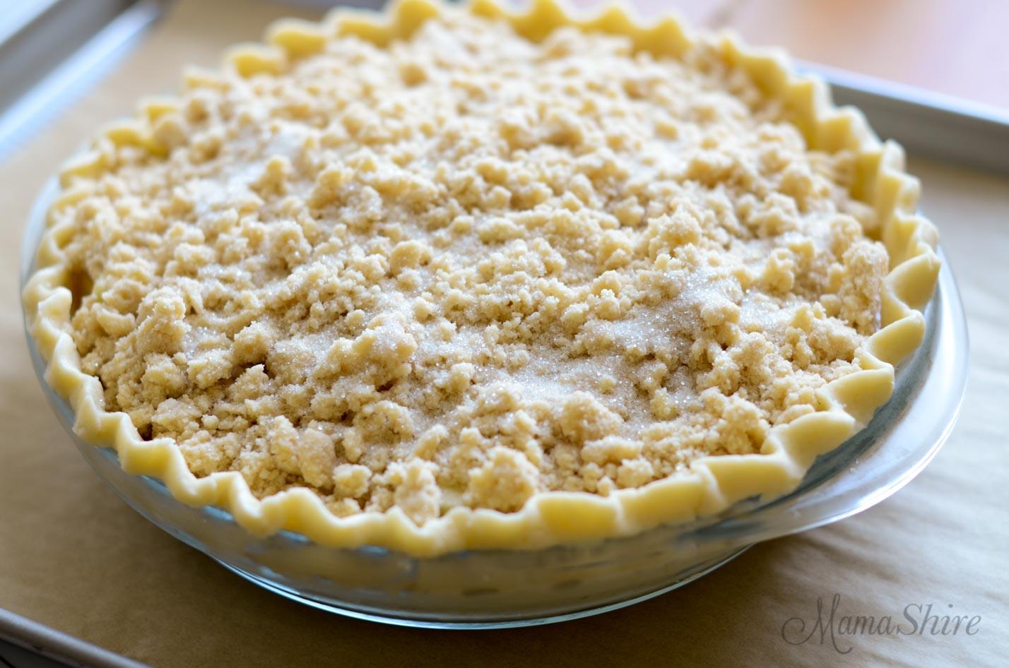 An uncooked gluten-free Dutch apple pie.