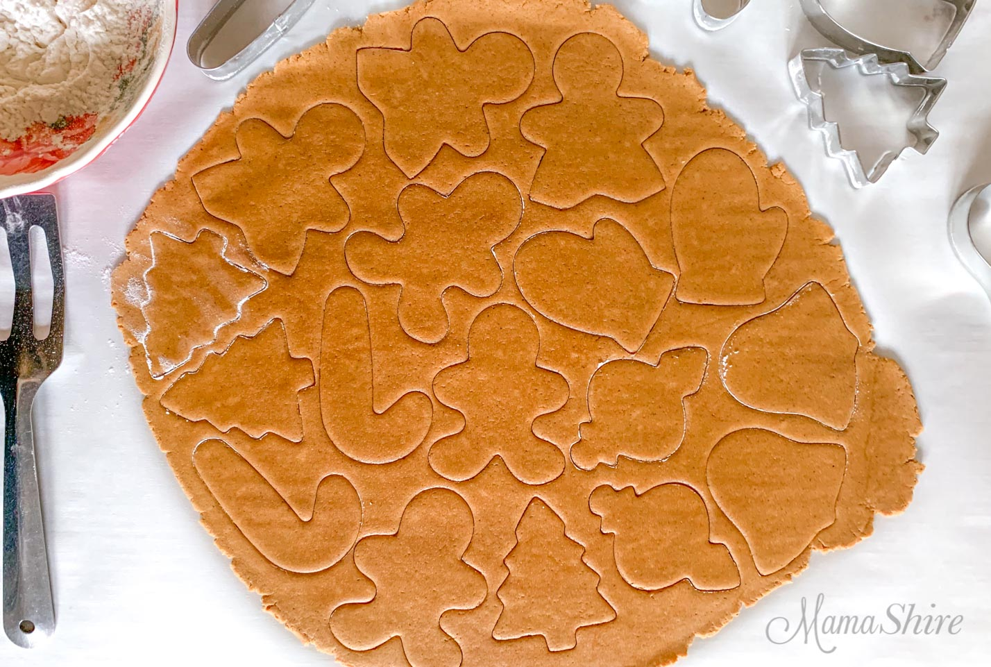 Gingerbread dough with Christmas cutouts.