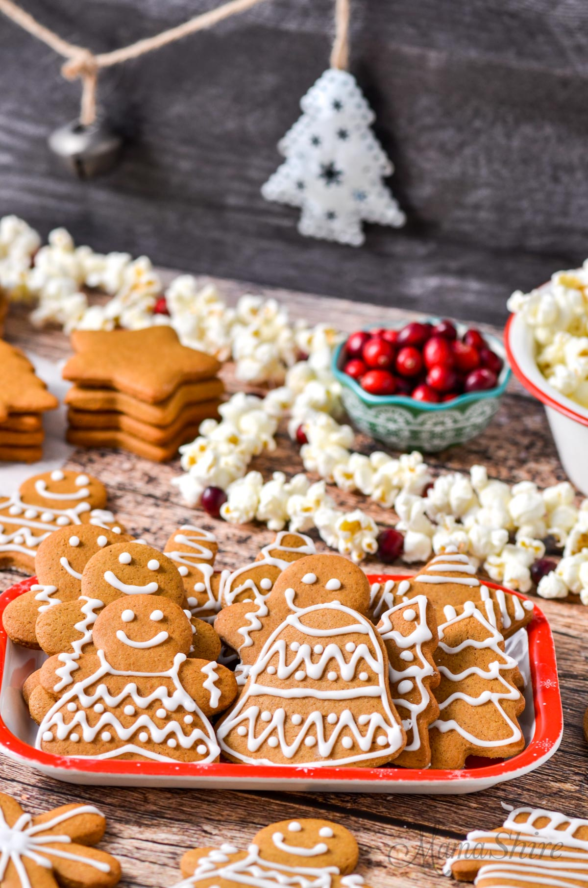 Christmas cookies with strands of popcorn and cranberries.