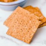 Graham crackers on a marble background. Crackers made with a homemade gluten-free graham cracker recipe.
