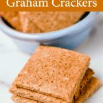 A stack of homemade gluten-free graham crackers and a blue bowl holding several more. Yummy homemade gluten-free graham cracker recipe.