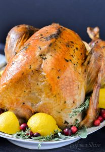 A delicious herb roasted turkey with lemons and herbs.