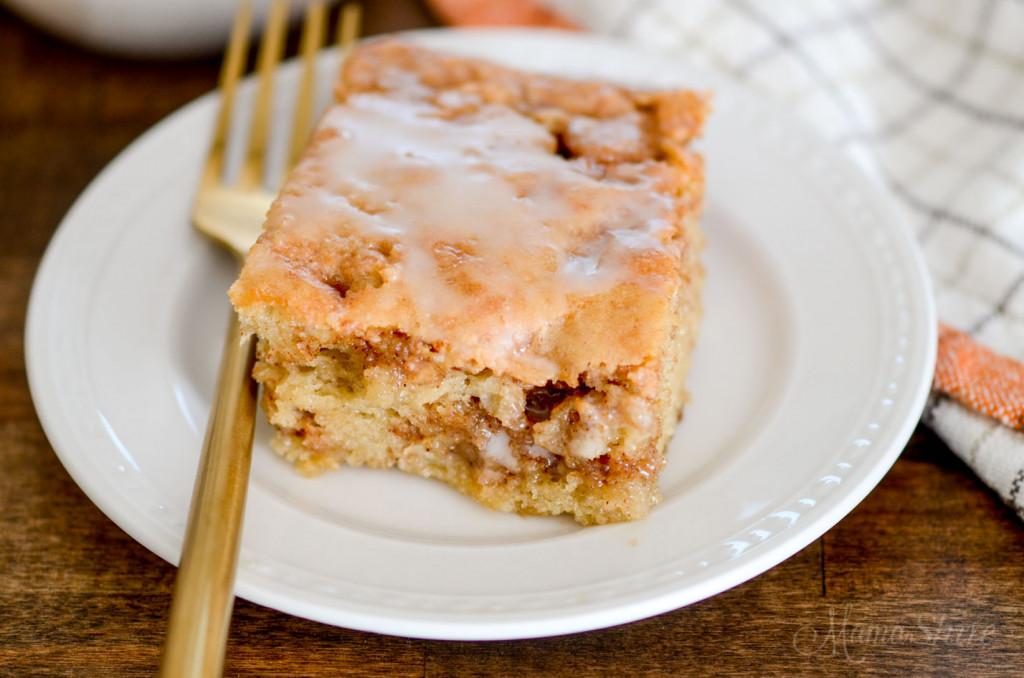 Cake with vanilla icing and brown sugar and cinnamon swirl.