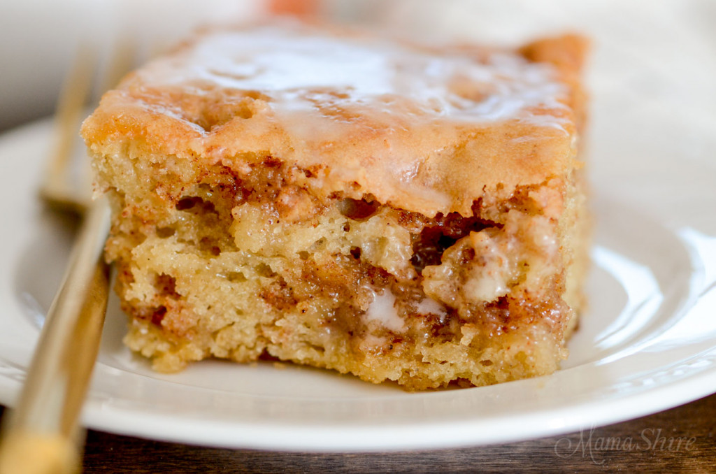 A closeup of a gluten-free honey bun cake with swirls of cinnamon and brown sugar througout.