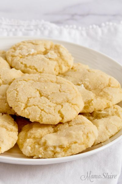 A white serving plate filled with gluten-free lemon cookies.