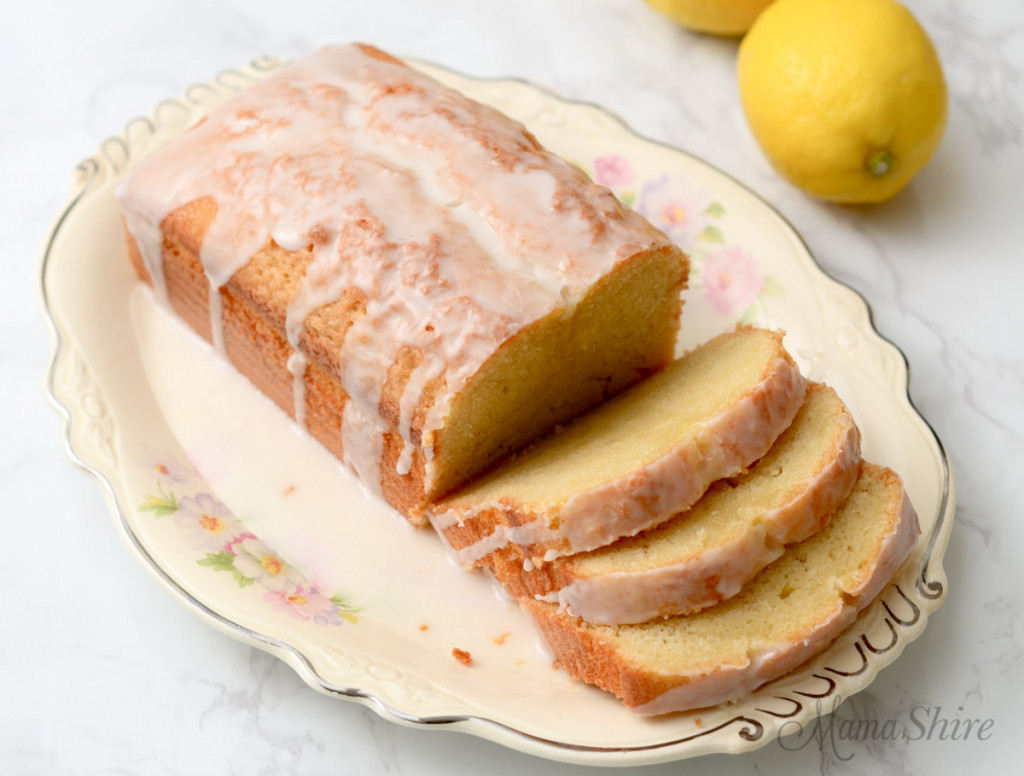 A plate of gluten-free lemon loaf with a few slices sliced.