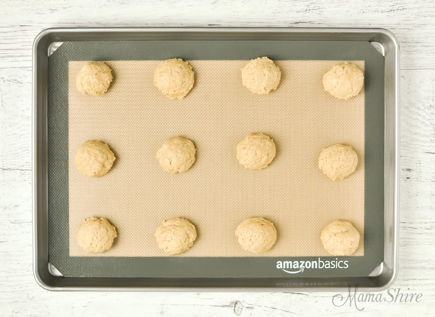 Cookie dough on a silicone baking mat.