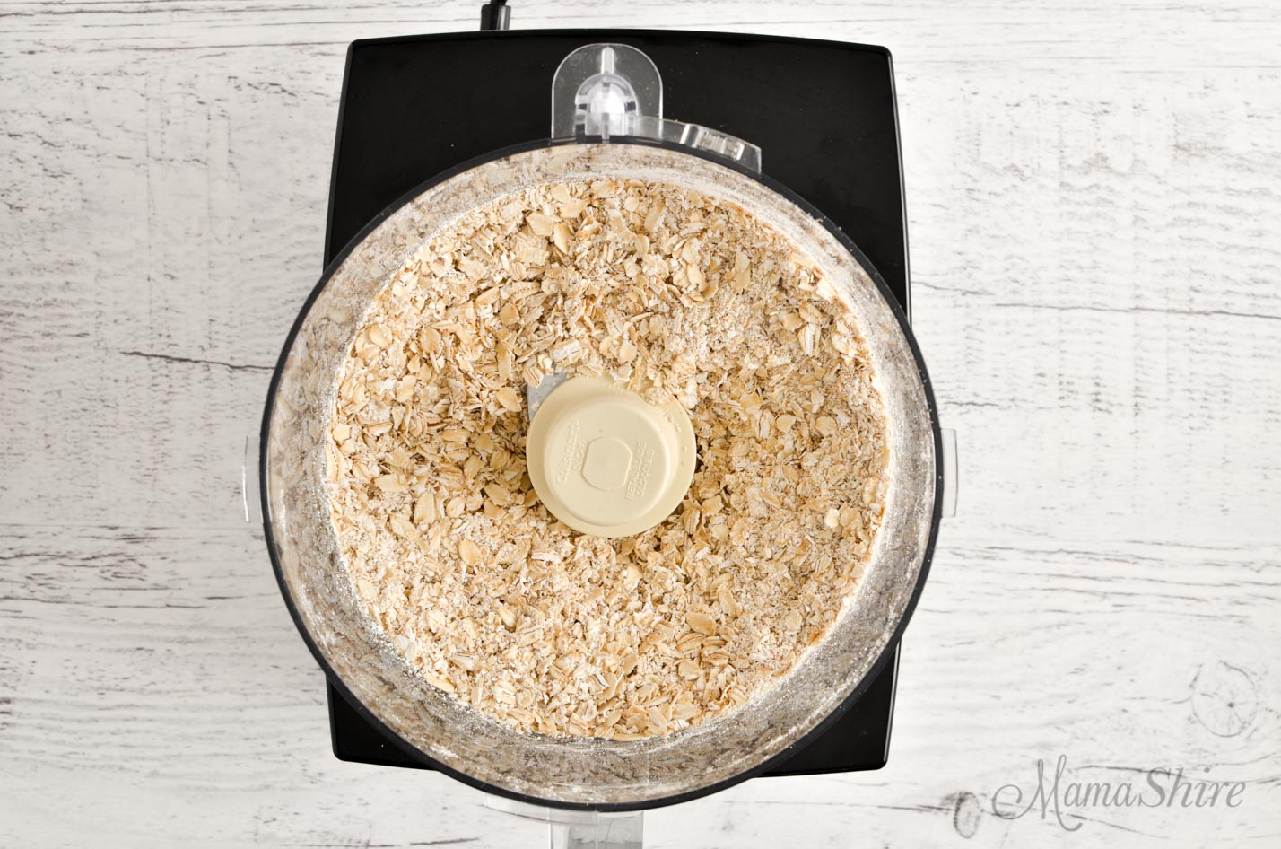 A food processor with quick oats made from pulsing old-fashioned rolled oats.