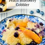 Peach Blueberry Cobbler on a pretty blue dessert plate.