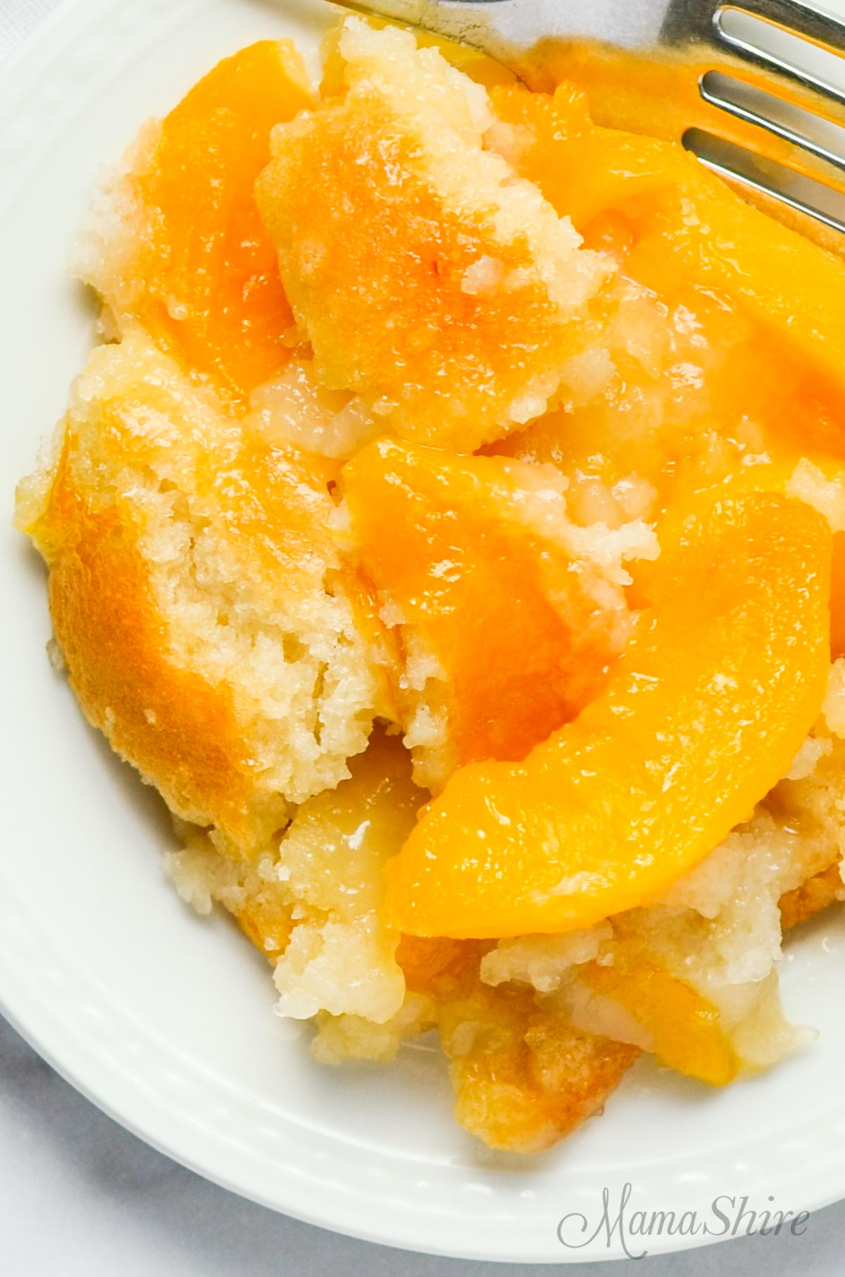 A serving of gluten-free peach cobbler.