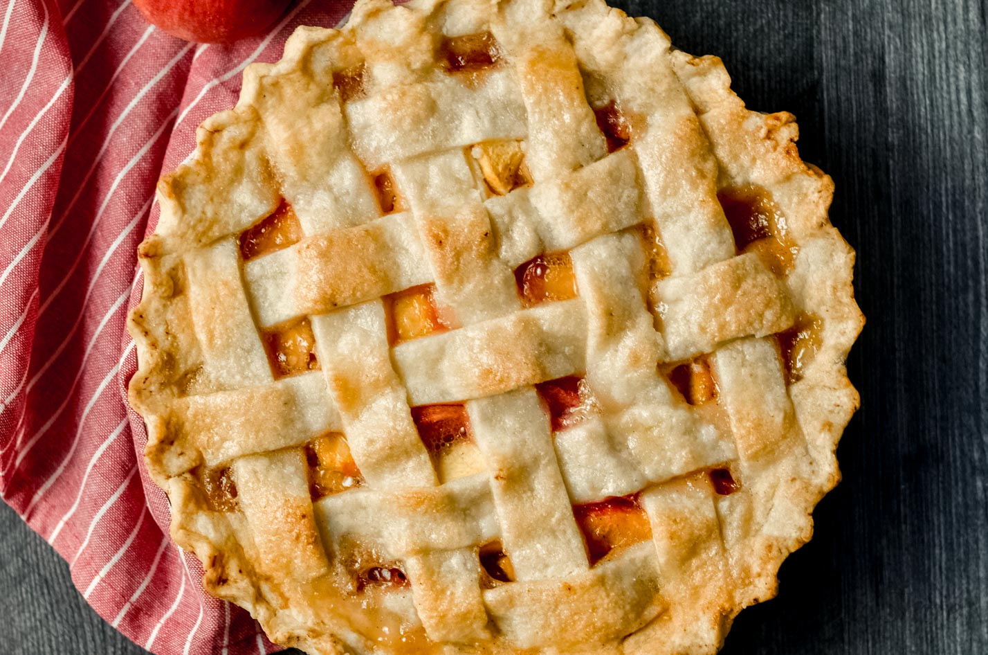 A gluten-free peach pie with a lattice topping.