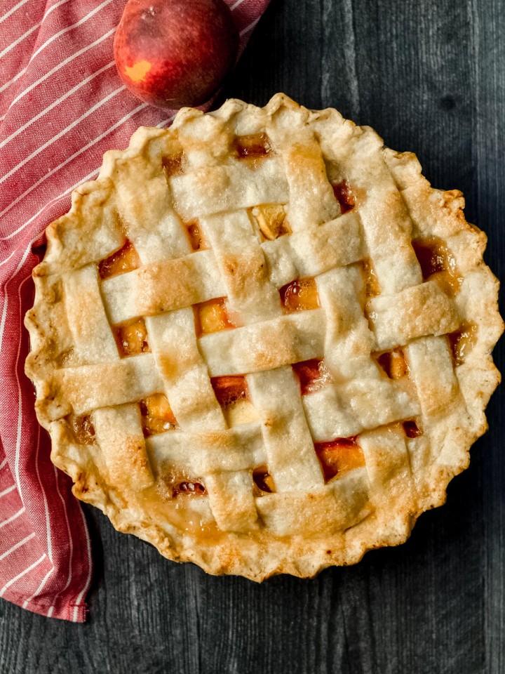 A homemade lattice topped gluten-free peach pie.