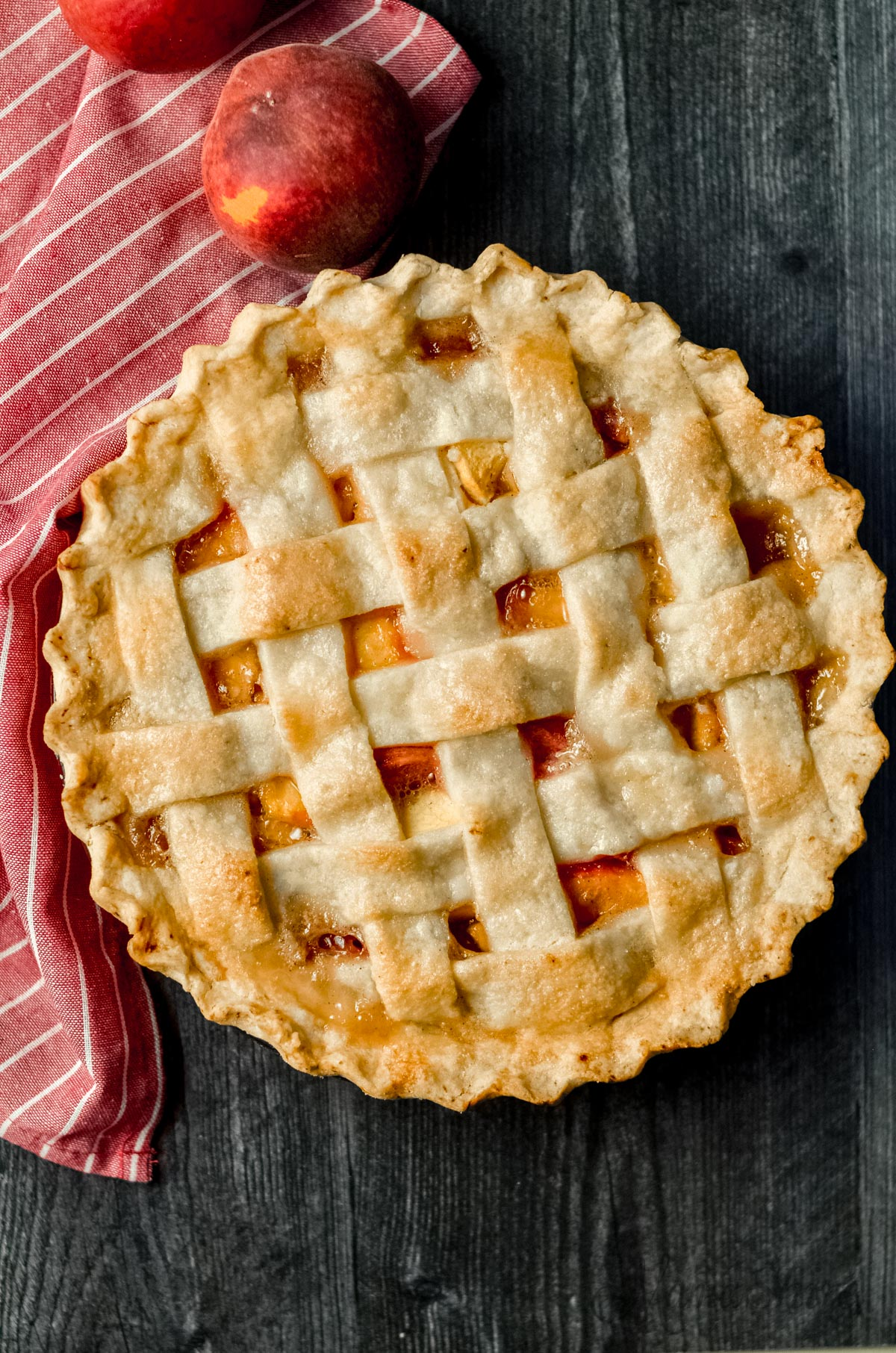 Gluten-free peach pie with a lattice top.