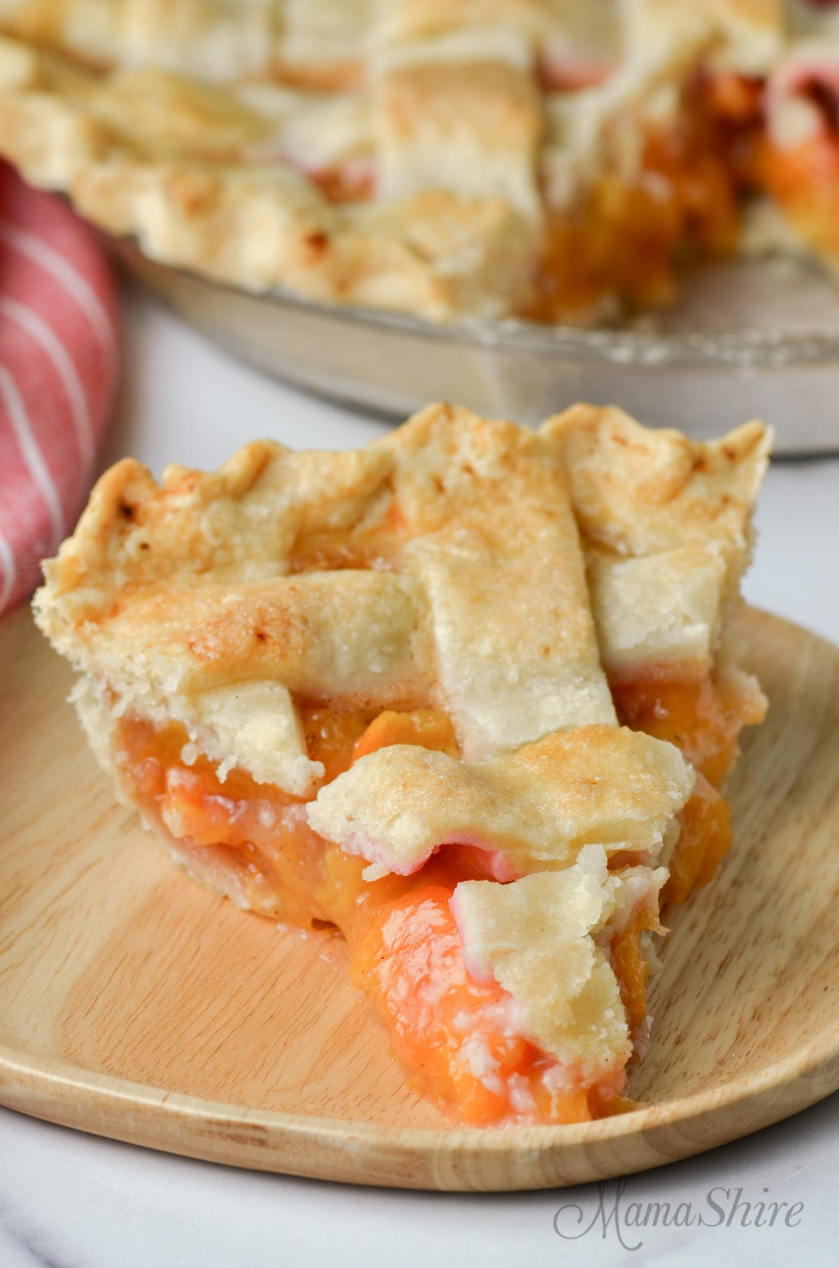 A nice big slice of gluten-free peach pie.