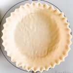 Gluten-free pie crust in a pie pan.