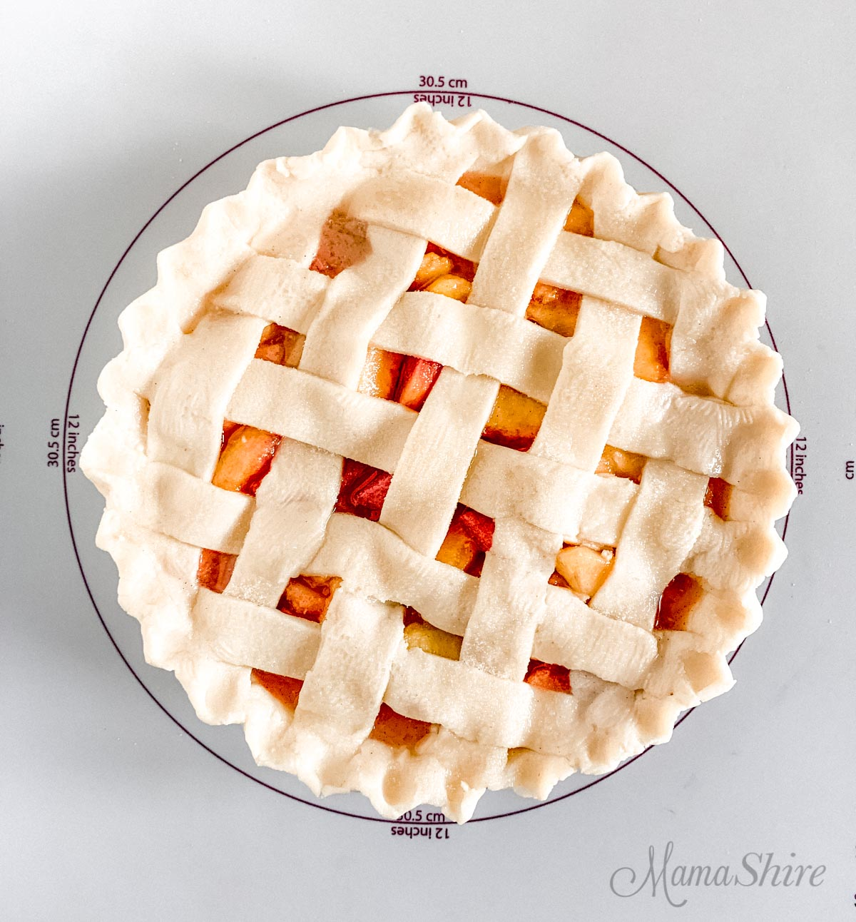A lattice top peach pie.