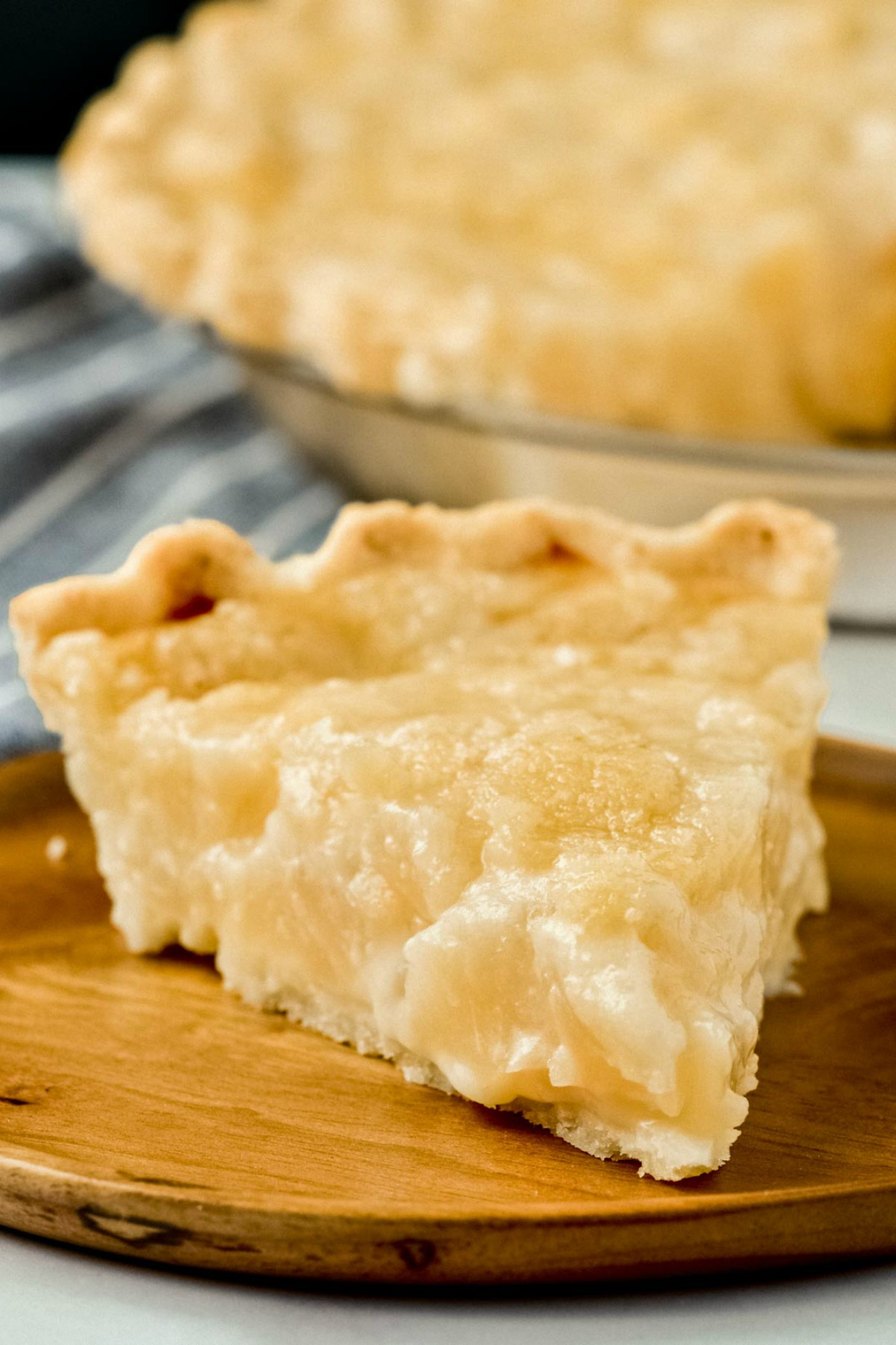 A slice of of pear pie with streusel topping. Gluten-free and dairy-free.