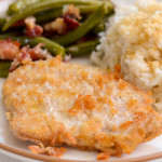 A simple and easy to make gluten-free pork chop on a dinner plate with sweet rice.