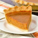 A single slice of gluten-free and dairy-free pumpkin pie.