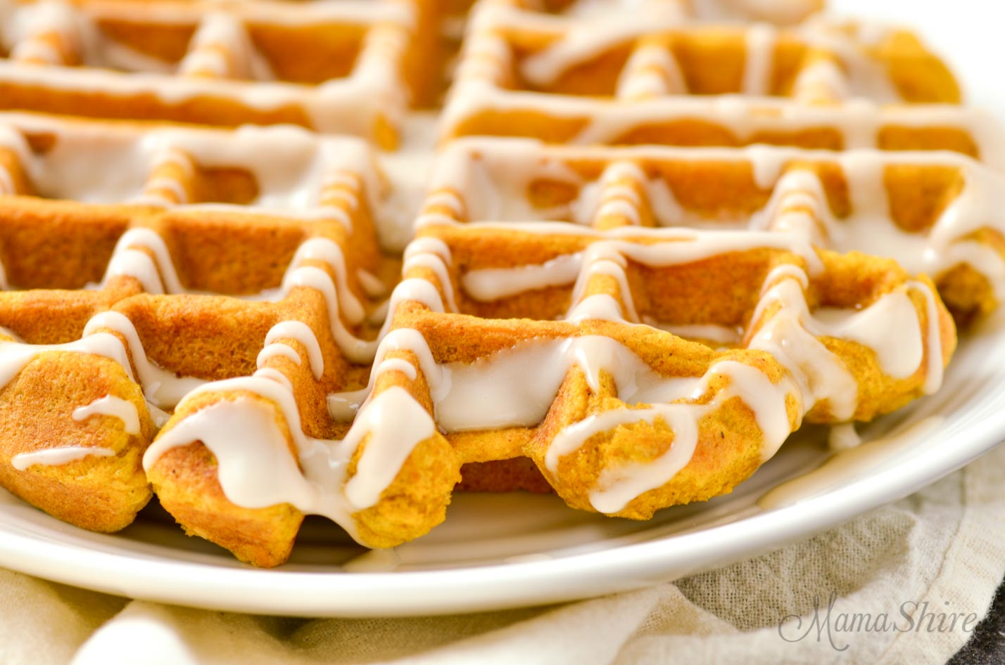 Pumpkin Waffles with maple syrup glaze are perfect for a Gluten-Free Breakfast.