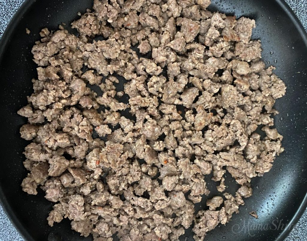Fried sausage broken up into small pieces ready to make into gluten-free sausage gravy.
