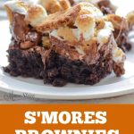 A picture of a chocolate brownie with s'mores ingredients