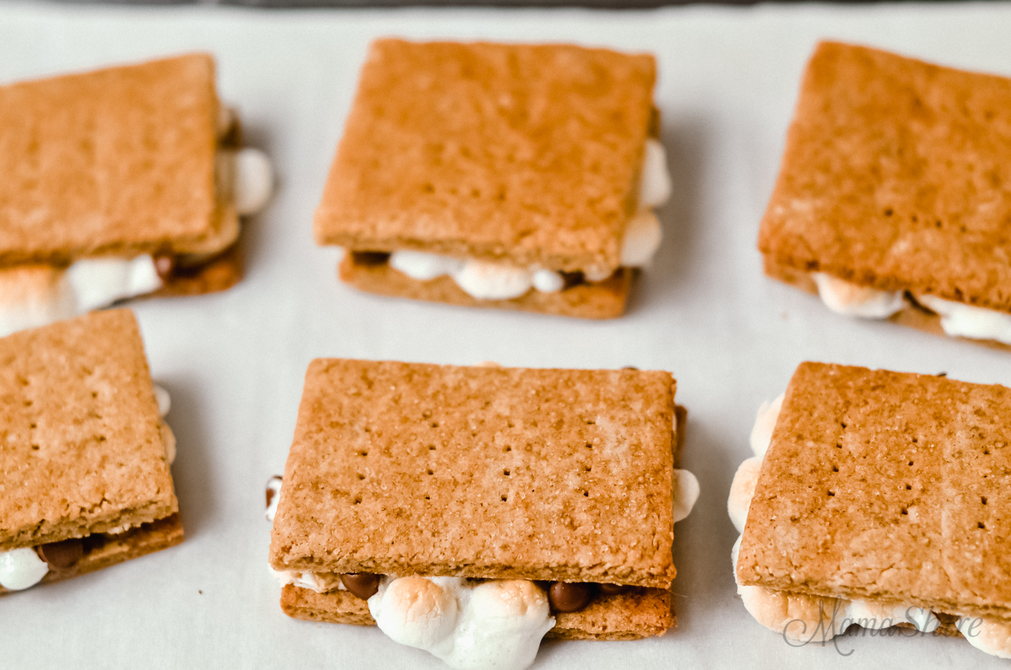 Gooey marshmallow coming out of gluten-free s'more oven baked.