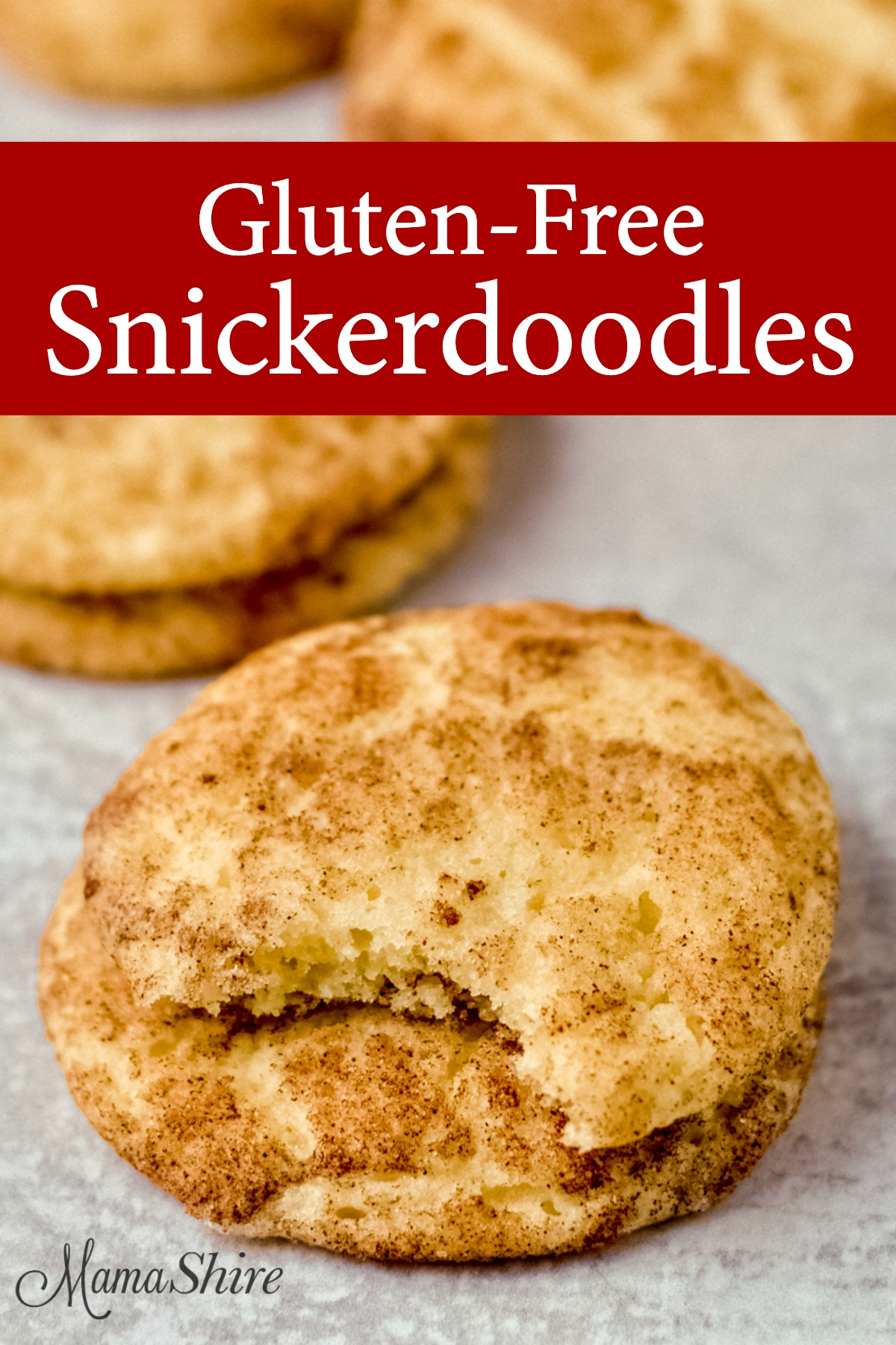 Gluten-free snickerdoodle recipe that makes these soft and tender cookies. One has a bite taken out of it.