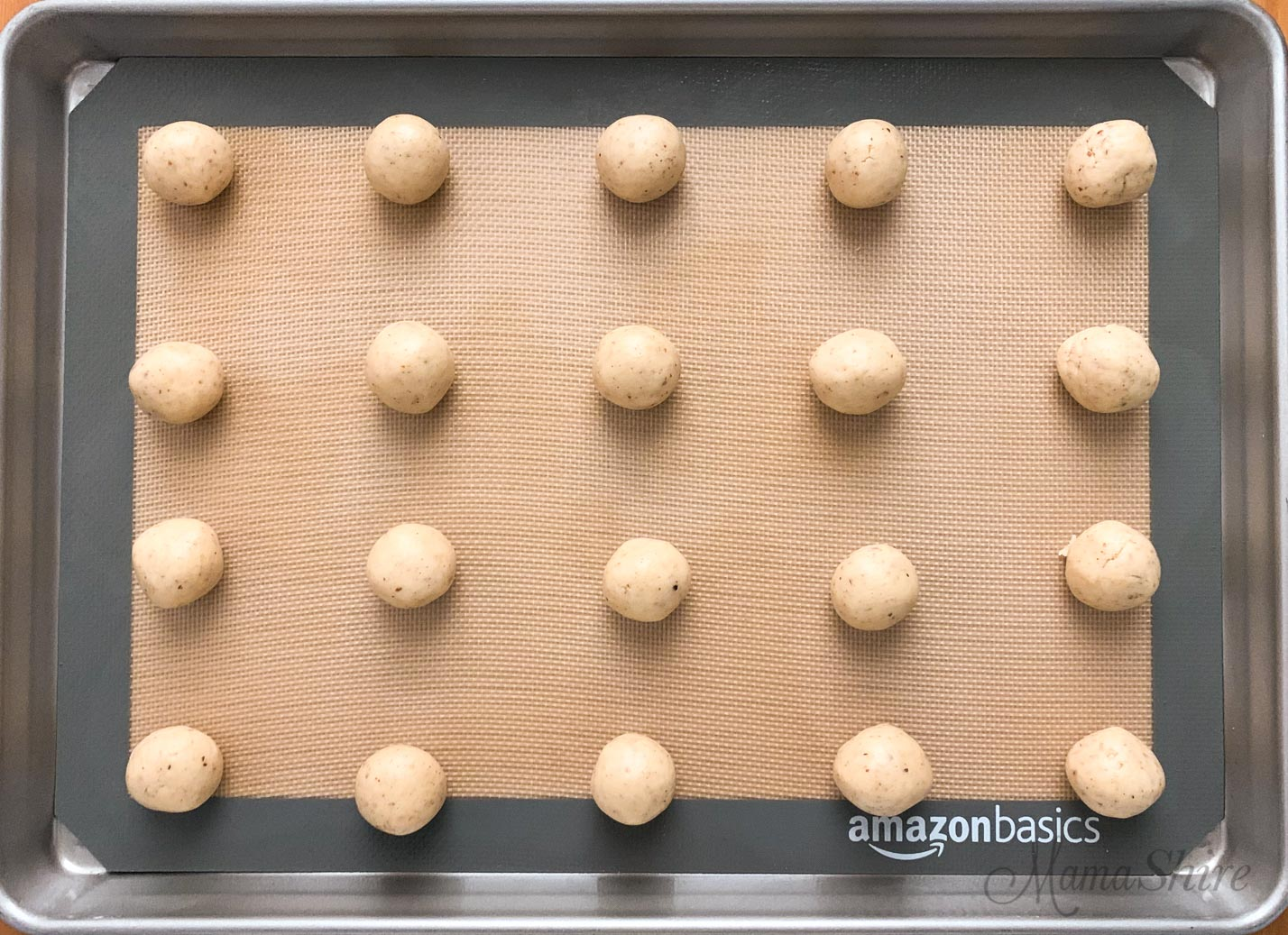Baking pan with gluten-free snowball cookie dough.