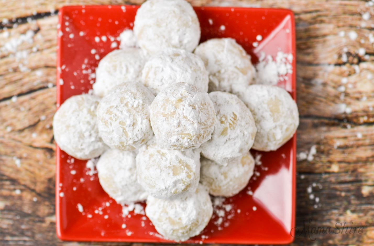 Pecan snowballs covered with confectioner's sugar.