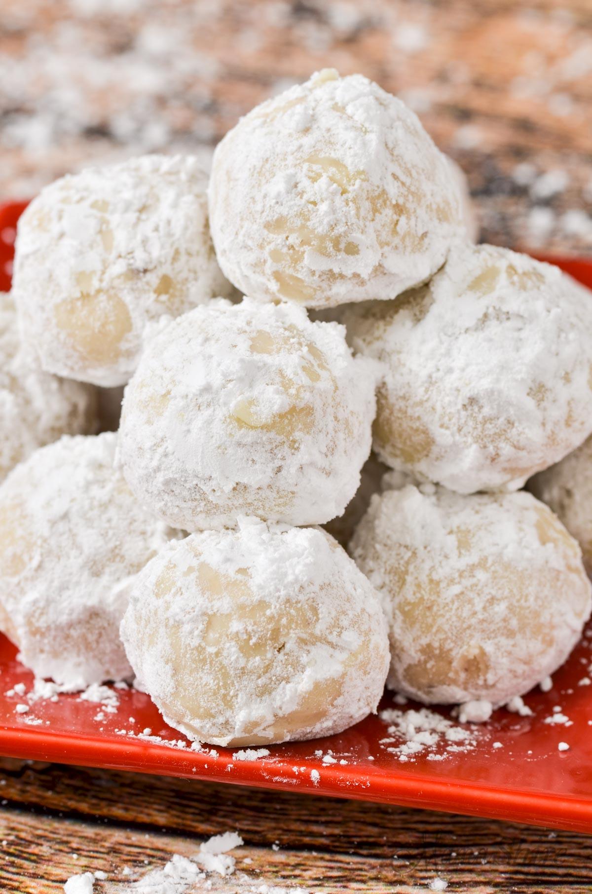 A closeup of little pecan snowball cookies.