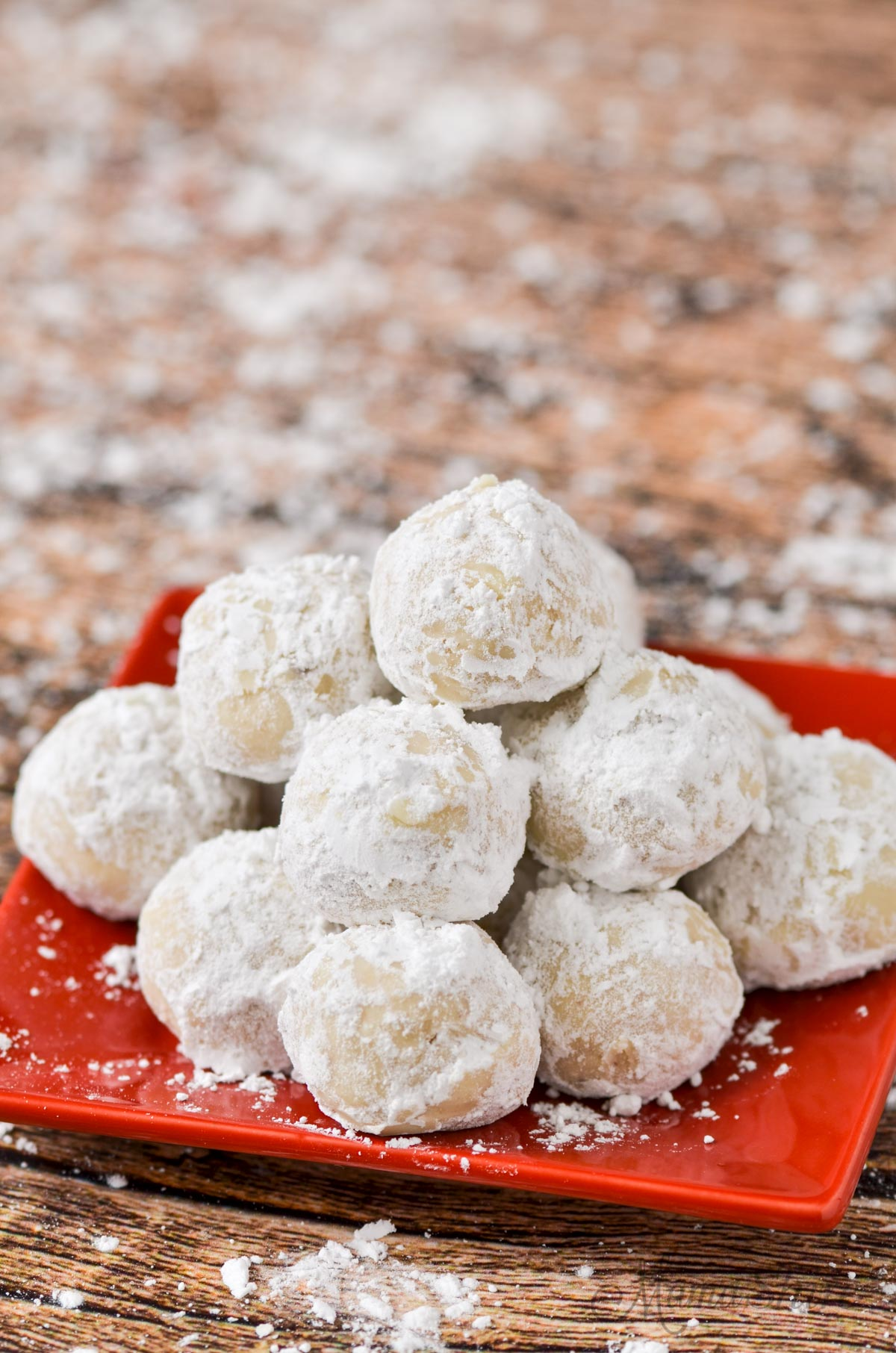 Little powdered sugar covered gluten-free snowball cookies.