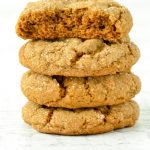 A stack of rich flavorful brown molasses cookies.