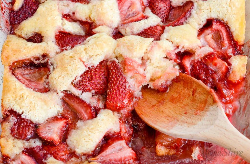 A closeup of strawberry cobbler.