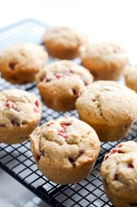 Freshly baked gluten-free muffins with strawberries.
