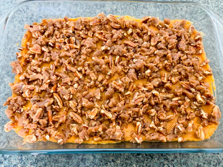 Casserole dish of sweet potato casserole before baking.