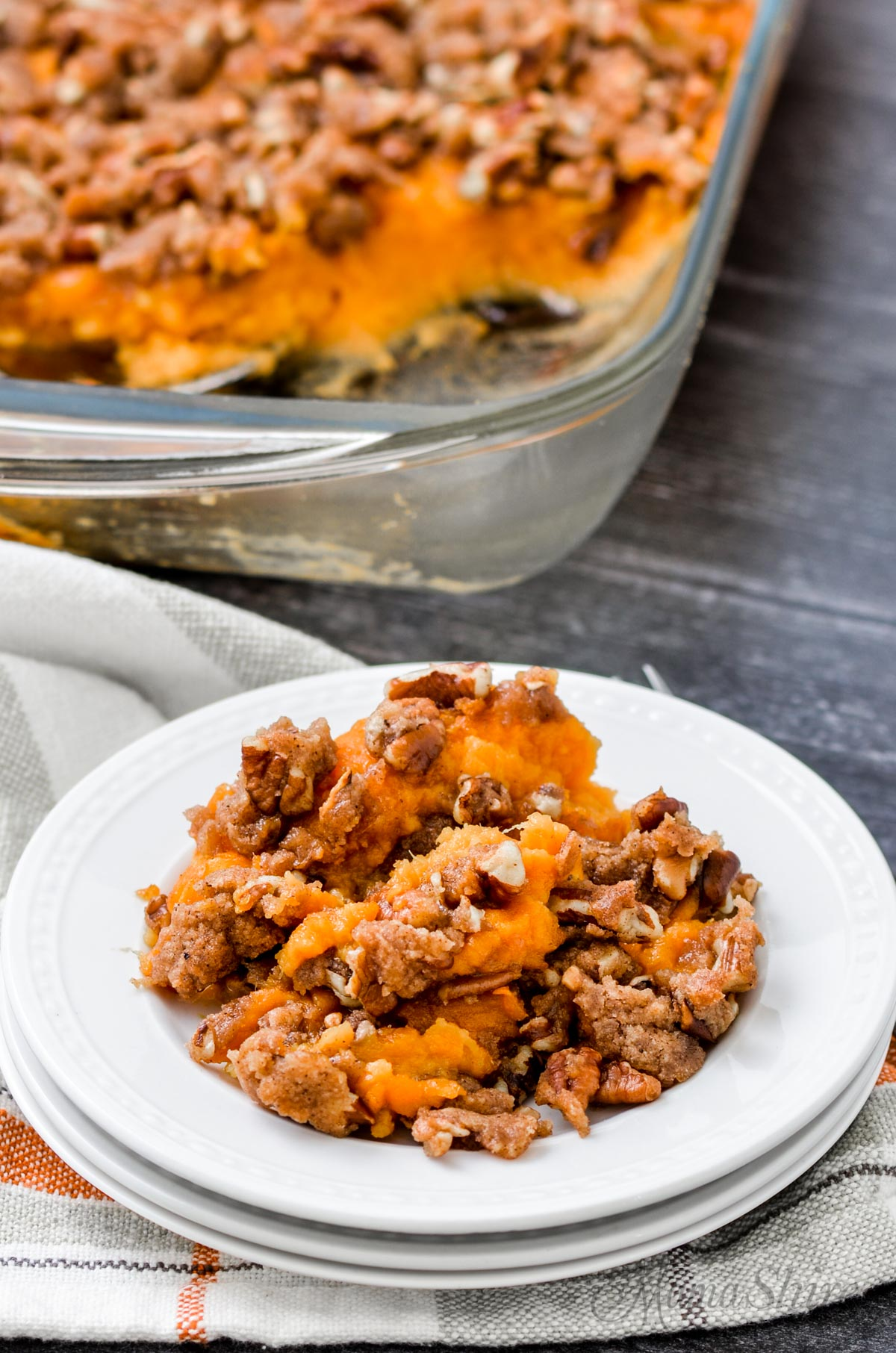 A white plate with a serving of sweet potato casserole.