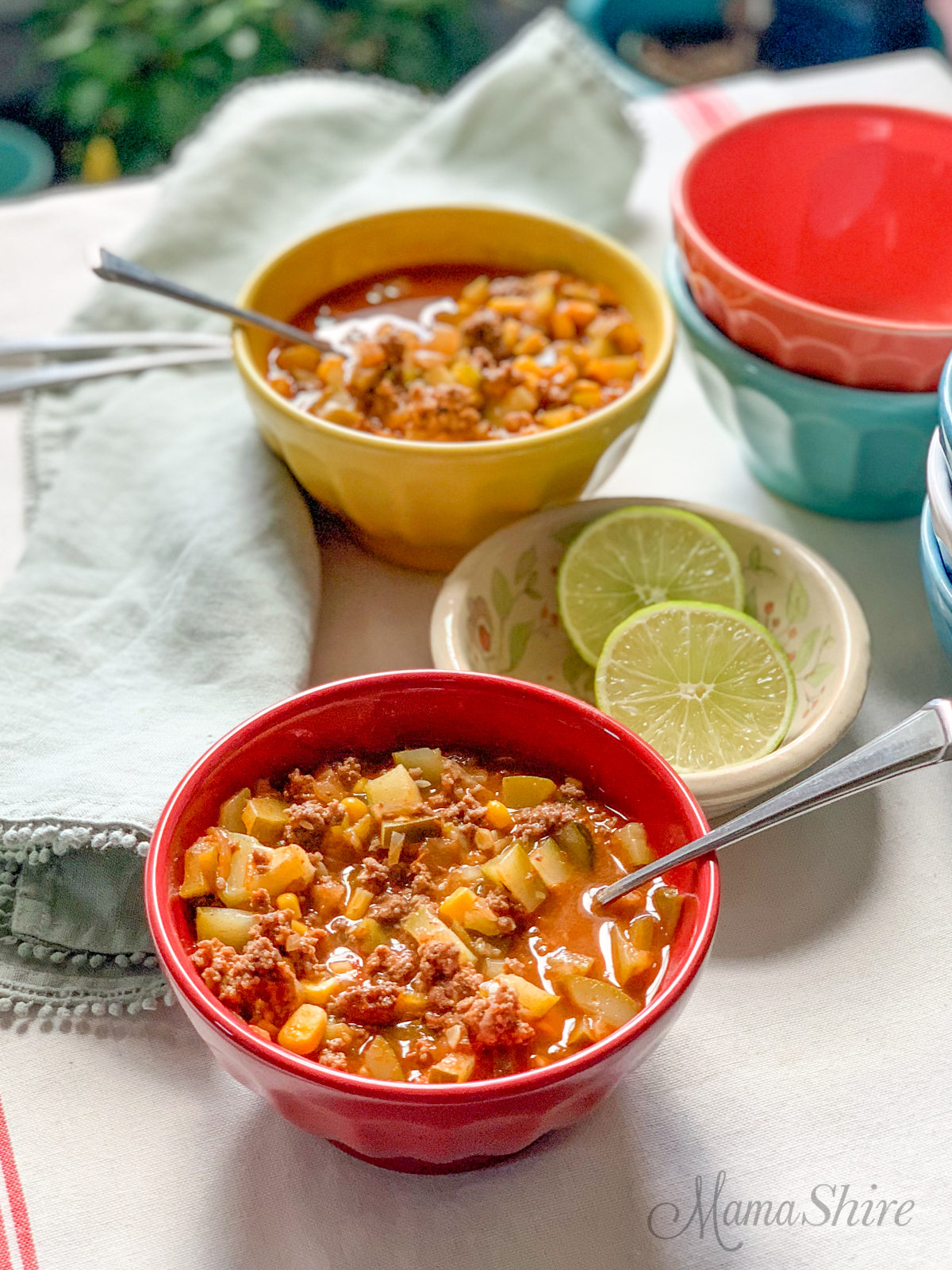 Gluten-Free Taco Soup with Zucchini served with lime slices.