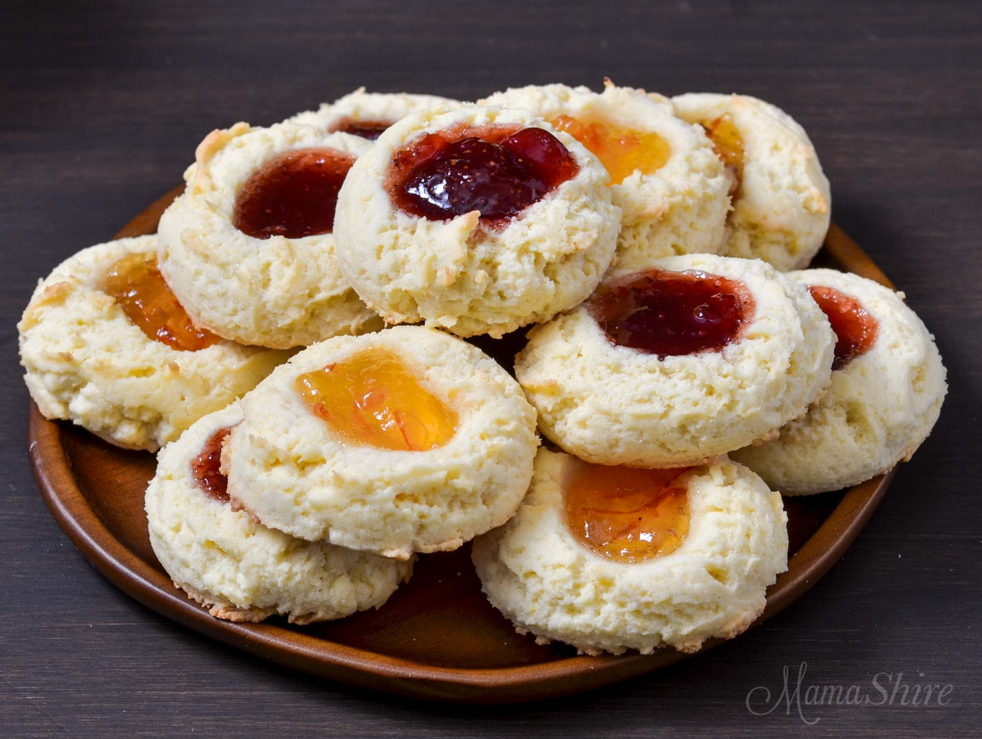 Gluten-free thumbprint cookies with orange marmalade and strawberry jam.