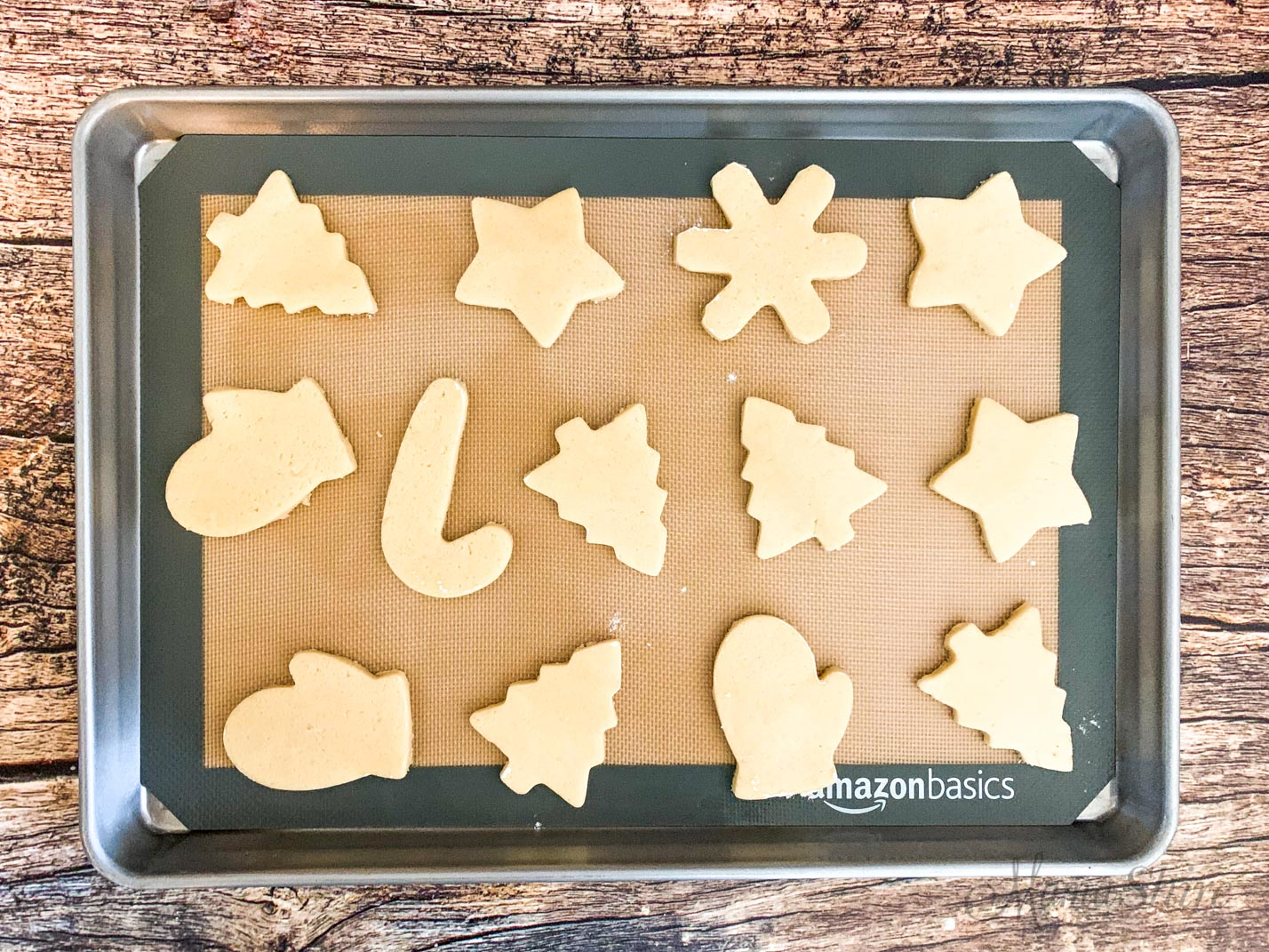 Gluten-free vanilla sugar cookie dough on a baking pan with a silicone mat.