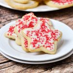 Gluten-free vanilla sugar cookies with icing and sprinkles.