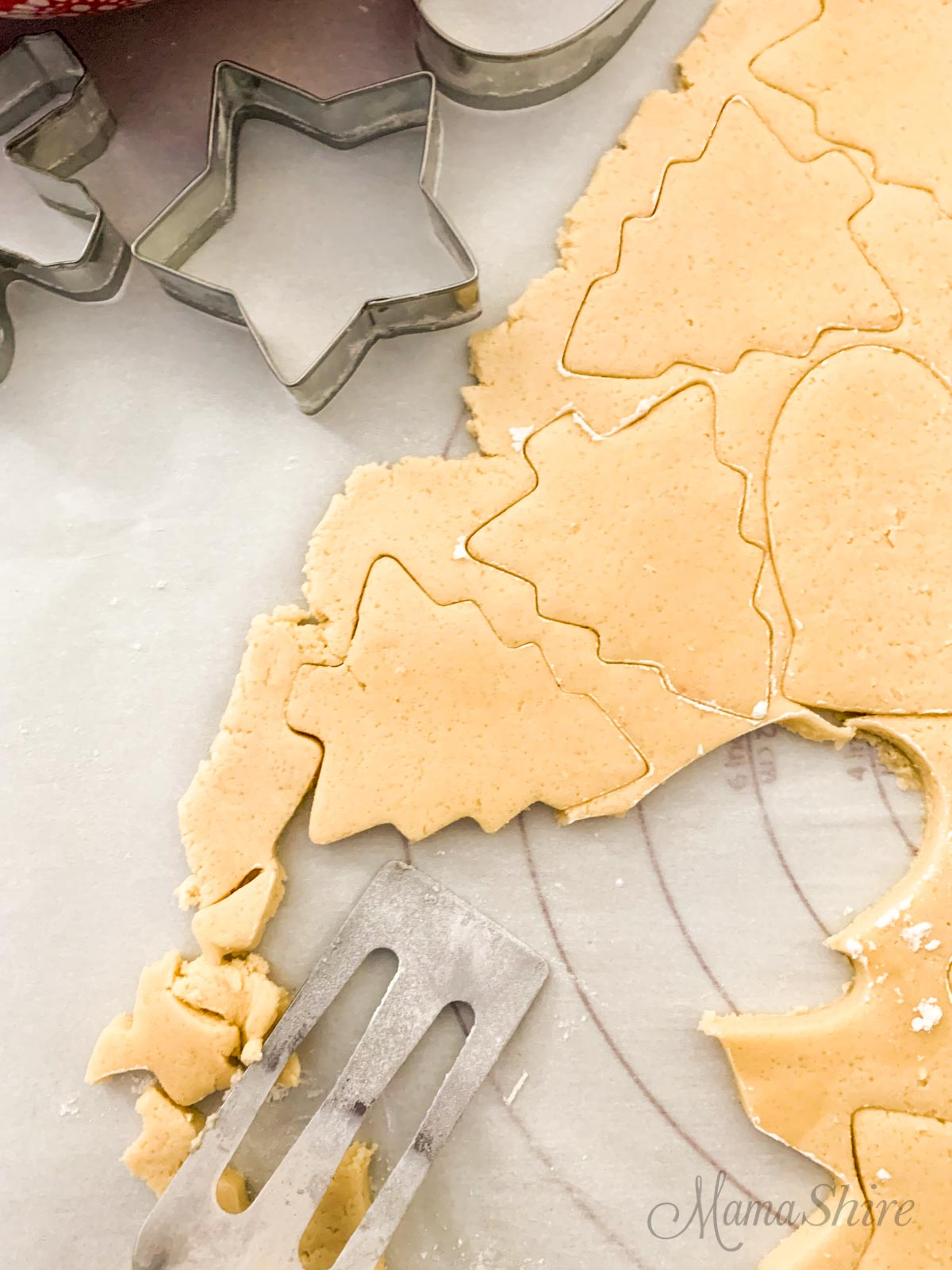 Use a spatula dipped in flour to move cookie dough to the baking pan.