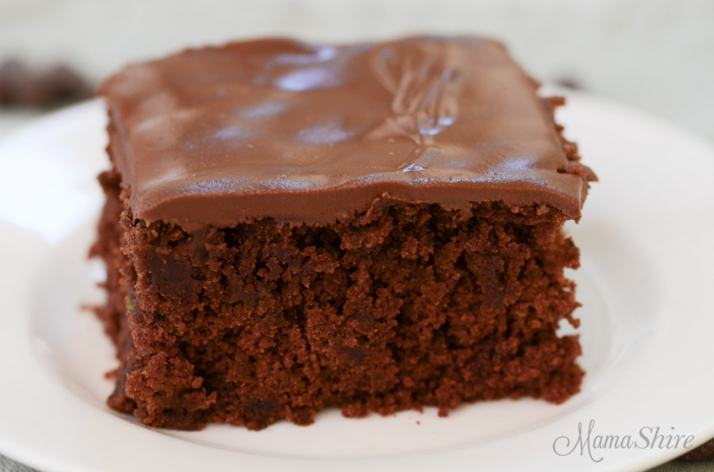 A closeup of a gluten-free zucchini brownie with chocolate peanut butter frosting.