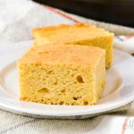 Cornbread squares on a white plate.
