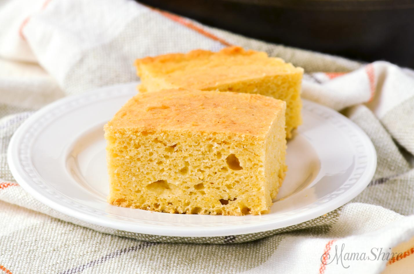 Cornbread squares on a white plate made from the best gluten-free cornbread recipe
