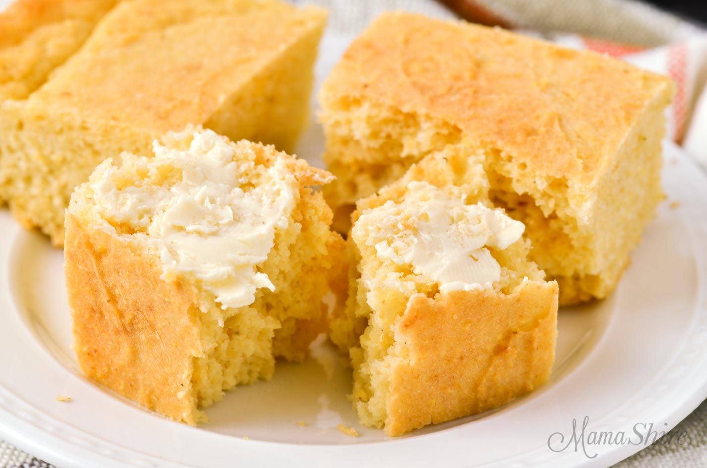 Gluten-free cornbread with Smart Balance non-dairy buttery spread on top.