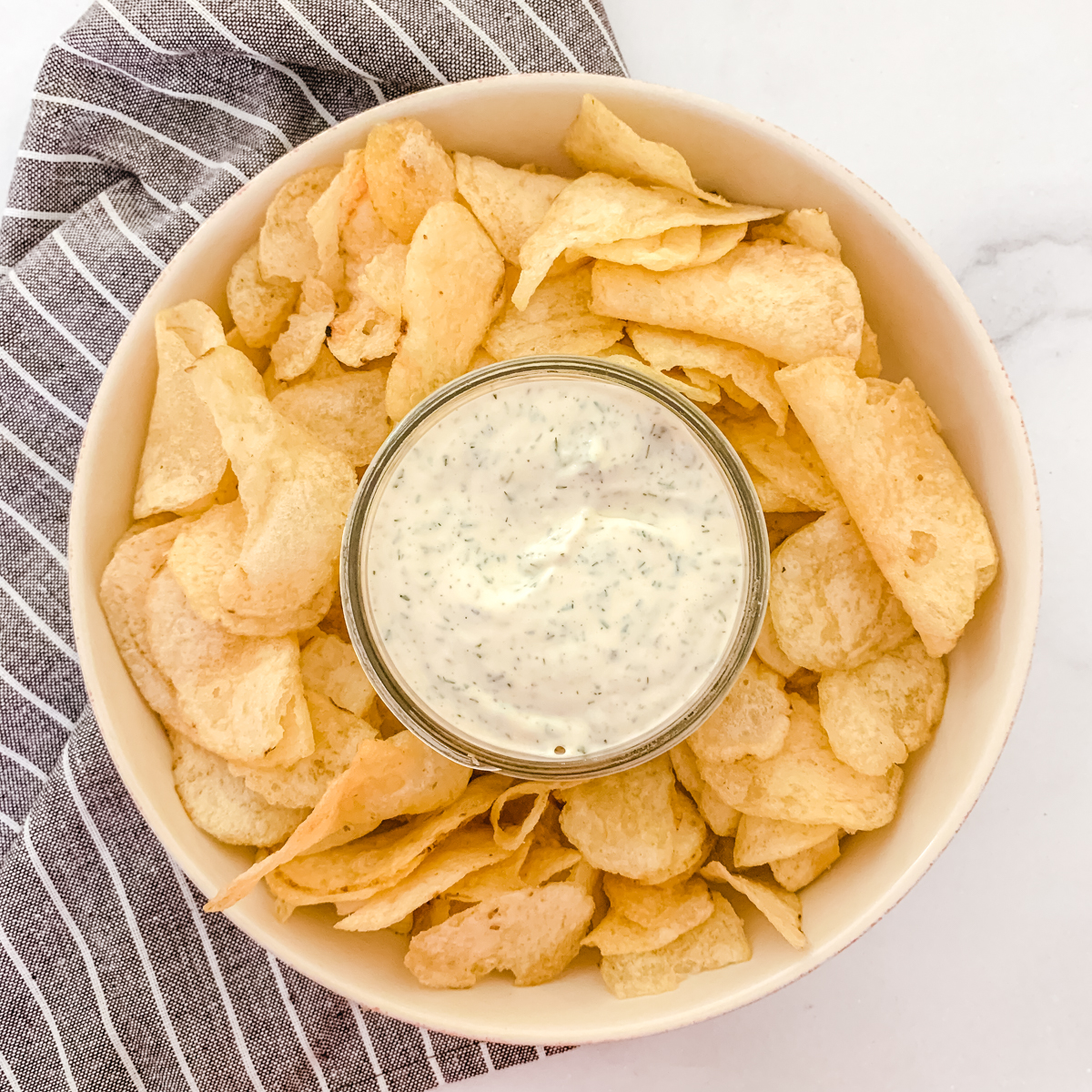 Homemade dairy-free ranch dip with chips.